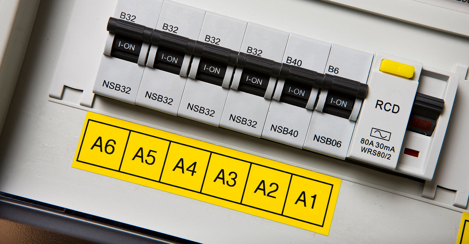 Consumer unit labelled with Brother black on yellow tape