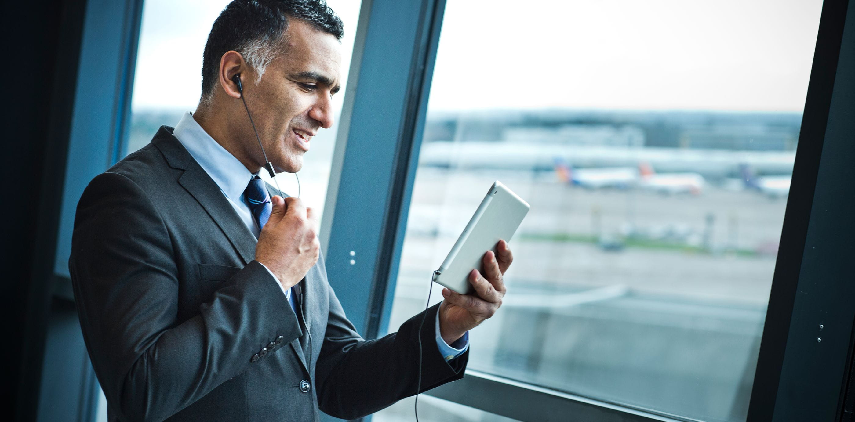 Brother OmniJoin man conducting web conference on tablet  at airport