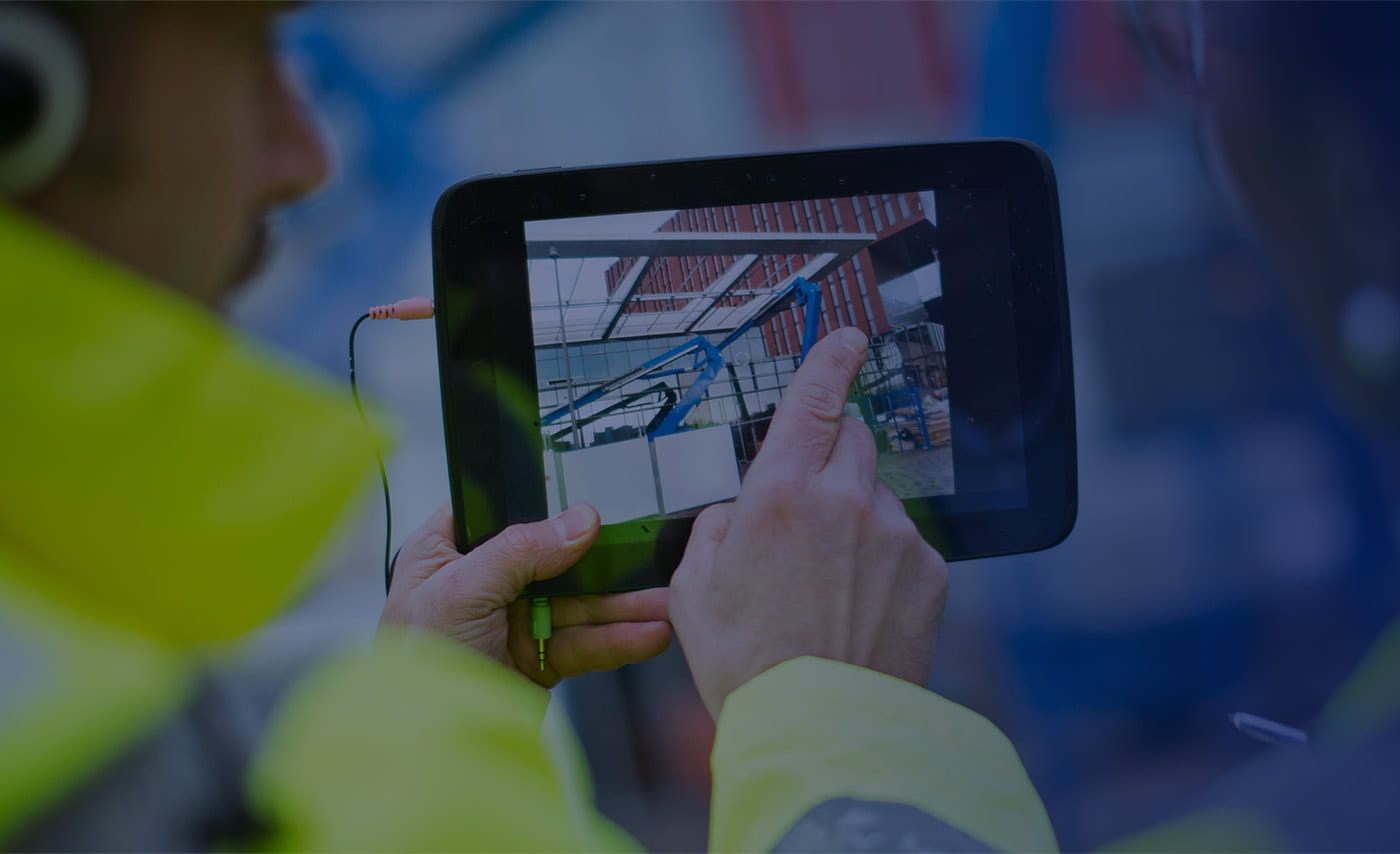Brother OmniJoin man in construction demonstrating on tablet